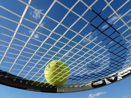 Tennis ball and racket graphic