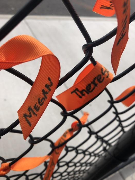 Closeup of personalized orange ribbons by Ridgefield School District students to support anti-bullying.