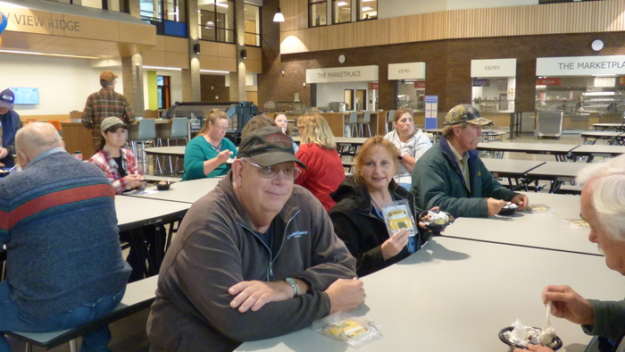 School bus drivers enjoy cookies and ice cream sundaes during National School Bus Safety Week