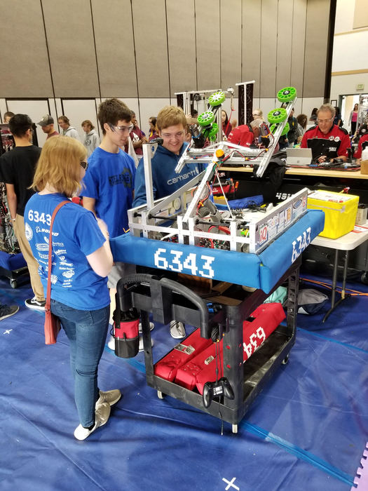 STEEL Ridge Robotics team collaborate during competition