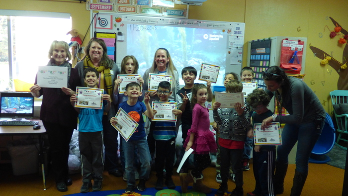 RISE students pose celebrate their awards for a phenomenal  Socktober Drive.