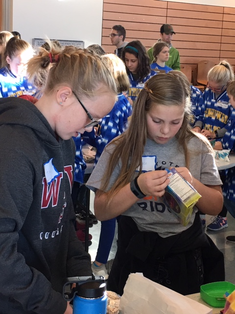 Kali Daarud and Nicolette Hulse work together at Elementary Science Olympiad Tournament