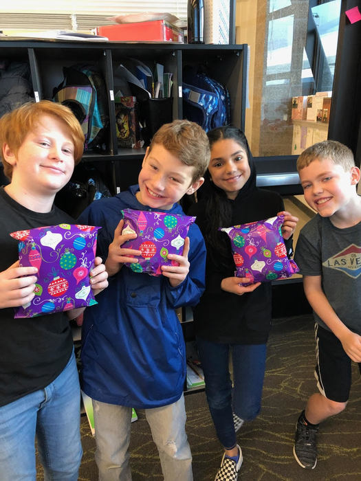 Ridgefield fifth graders display gifts wrapped for Ridgefield Living Center residents.