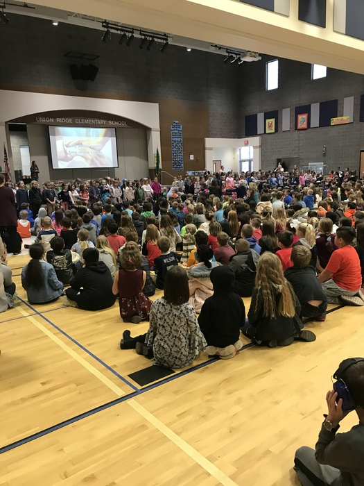 Kindergartens and 1st graders singing a song about diversity at the assembly on 1/18/19