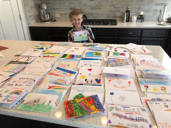 Anthony Moro-Baxter with cards created for his Hand to Heart Project.