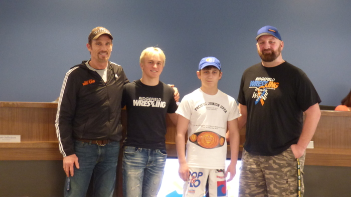 Wrestlers Dylan Draper and Bracen Nash with coaches