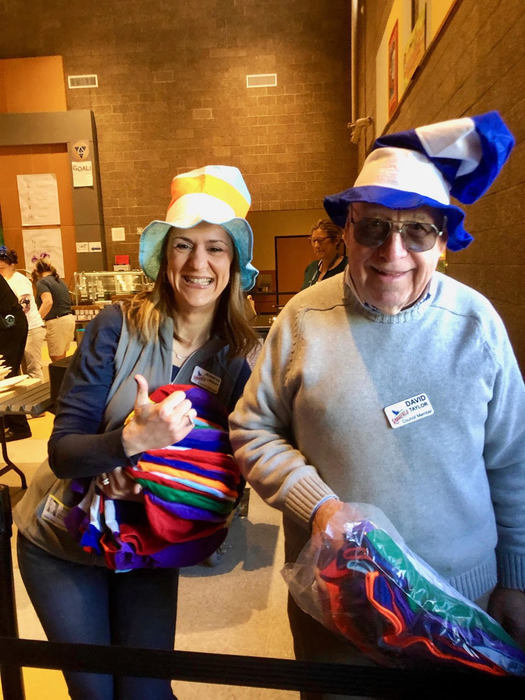 Ridgefield City Council members Jen Lindsay and Dave Taylor pass out hats at Green Eggs & Ham Breakfasts.