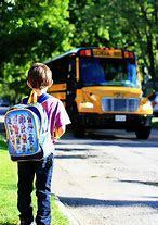 Photo of student waiting for bus