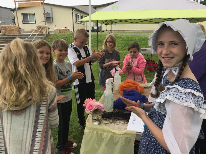 South Ridge students learn to make yarn on Pioneer Day