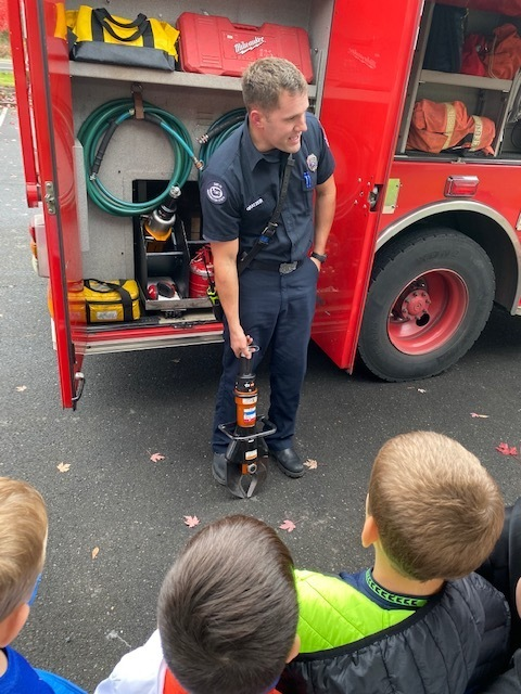 Checking out the fire truck and it's tools!