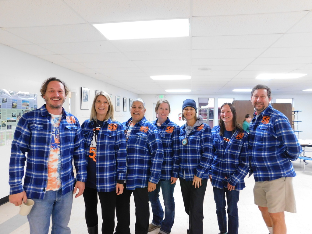 Cispus staff model the 50th Anniversary flannel shirt