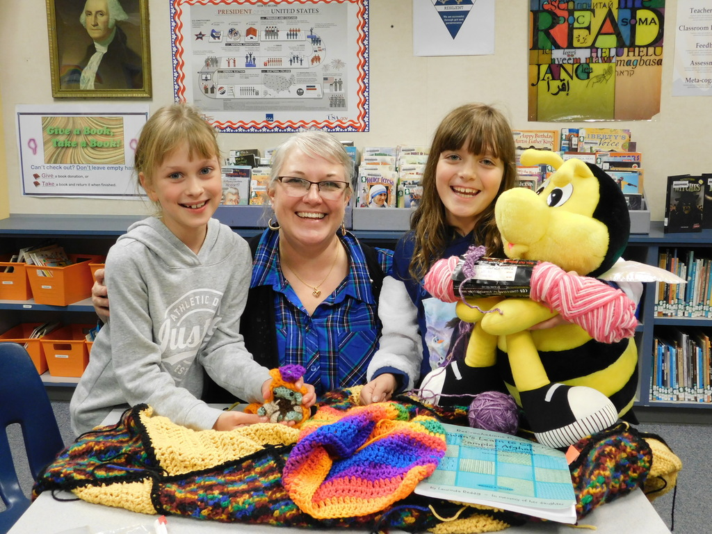 Emily Crawford and students at South Ridge Elementary show Crochet Club projects