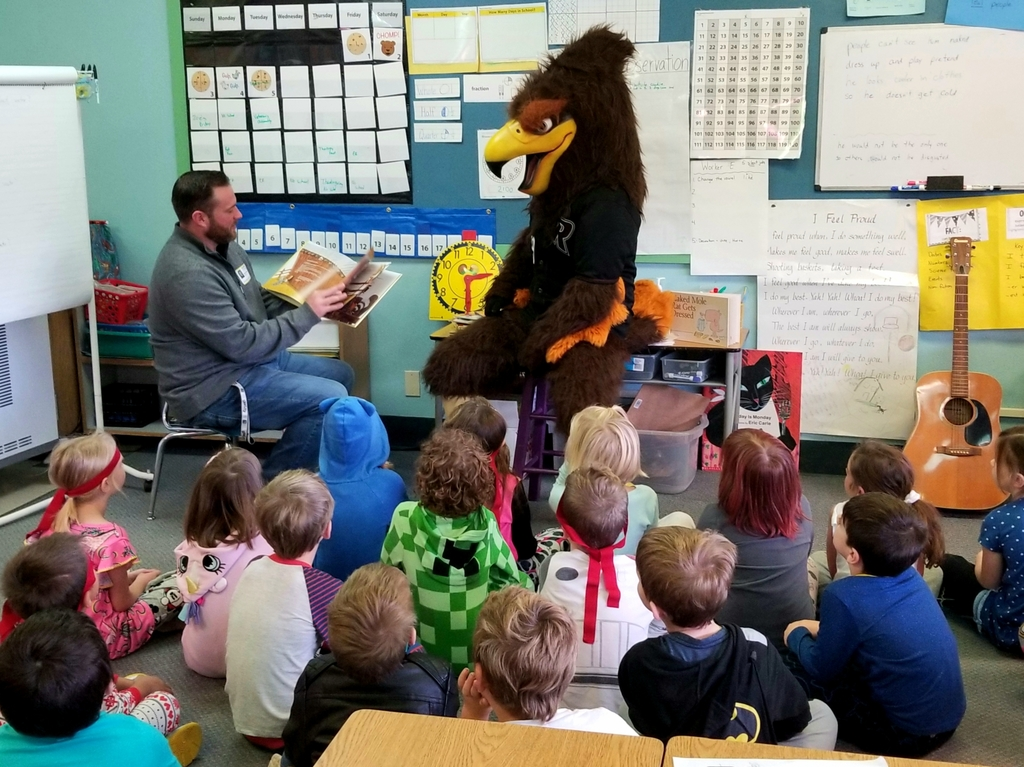 Rally the Raptor visits Union Ridge students during Read a Thon celebration.