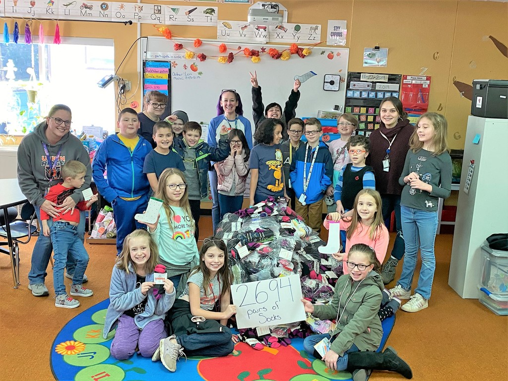 Stephanie Brown's RISE class and the socks they collected for this year's SOCKtober Sock Drive.