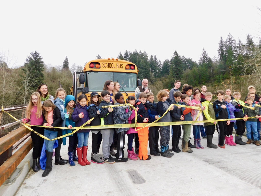 Students from South Ridge Elementary and RHS cut the ribbon to open the new Wildlife Refuge Bridge