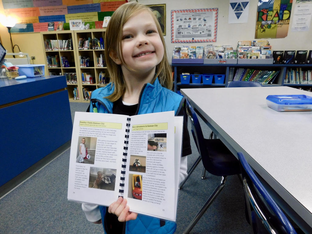 Teegan Thompson shows the pages she created in a Flat Stanley Adventures book