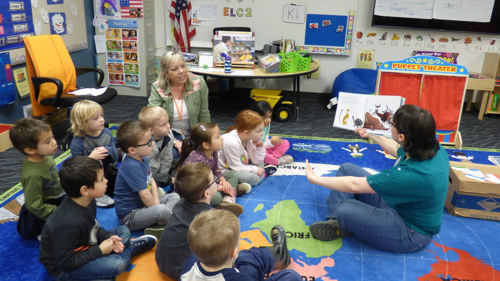 Ridgefield librarian Kathlleen Mintz reads a story to preschoolers at the Early Learning Center.